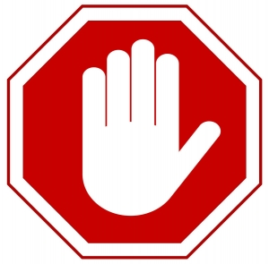 this is a picture of hand in front of a stop sign indicating HALT